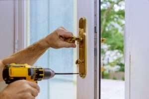 Locksmith installing new lock or repair the door lock