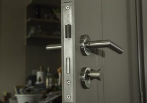 Door lock and silver handle. Services offered by residential locksmiths.