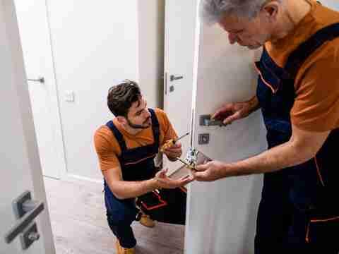 Locksmiths repair door lock