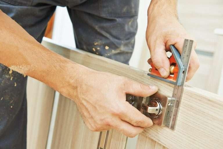 Professional lock installation into wood door