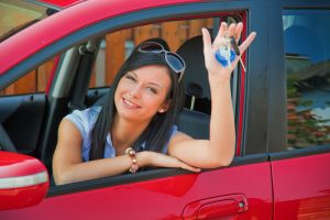 Woman with new car keys